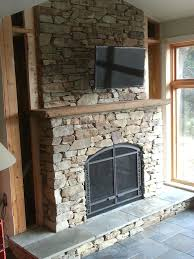 stone surround for fireplace stack stone fireplaces with plasma mounted stone around fireplace pictures