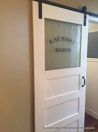 adding the finishing touch to the laundry room a sliding barn door