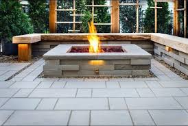 capture a lakeside or cabin setting with the manteo 70 outdoor patio fire pit table enjoy the flickering flames from this solid magnesium oxide