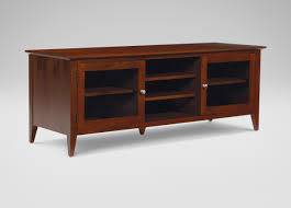 Short Media Cabinet Long Brown Wooden Cabinet With Two Shelves On The Middle Of