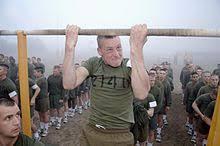 a marine performs chin ups