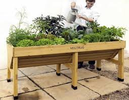 raised timber vegetable planter on legs