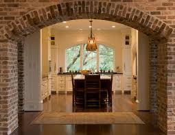 Segmental Arch Design Brick Hallway Arch With White Kitchen Island And Segmental