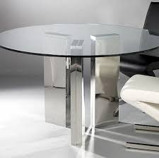 the round glass dining table from laflat features curving legs that give the piece a one of a kind look