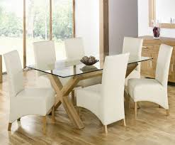 simple modern custom rectangle glass top dining tables with cross wood base and white leather chair cover ideas