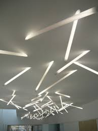 the polycarb stick light is a t5 fluorescent light fixture consisting primarily of an illuminated that penetrates a ceiling cavity at an angle