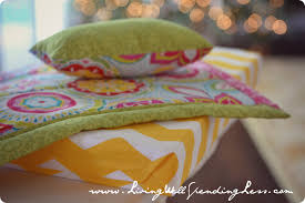 the matching pillow and contrasting sheet look great with our american girl doll bed