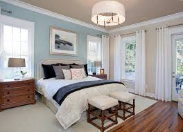 most popular bedroom furniture. Traditional Master Bedroom With Blue Beige Walls Also Gray Black Bed And Wood Floor Laminate White Window Draperies Natural Picture Frame Above Most Popular Furniture