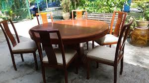 7 6 seater rosewood round dining table with 6 chairs 1