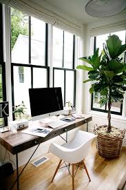 office at home. natural clean office space with wicker basket pot for the tall indoor plant mac book window black piping at home o