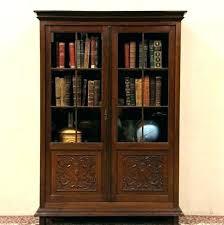 ikea hemnes bookcase glass doors black brown with