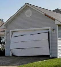 broken garage doorGarage Door Repair  Millwood Homes