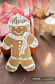 gingerbread man on wooden surface stock photos