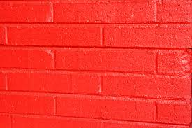 free photo of red painted brick wall texture