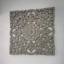 large grey hand carved wooden panel