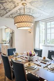 Transform an all-white dining room with wallpaper on the ceiling and a  classy chandelier
