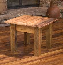 furniture reclaimed barn wood accent table placed on wooden floor