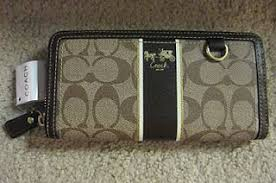 41658 COACH HERITAGE STRIPE ACCORIAN ZIP WALLET Style   41658. Color  Black,  Mahogany , Berry Measures approximately 8 (L) x 4 (H) Coach khaki signature  ...