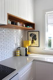 Lovely A Touches Of Wood In A White Kitchen   Wooden Boards With Built In Lighting