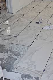How To Tile A Bathroom Floor Video Flooring How To Lay Tile Flooring Over Plywoodhow Floor In