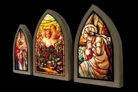 internally lit stained glass artwork or light boxes hang on the wall these windowless windows create the appearance of a stained glass window