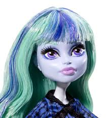 twyla doll accentuates her haunting features with boo tiful makeup and a colorful streaked hairstyle