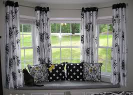 bay window seat curtains between windows