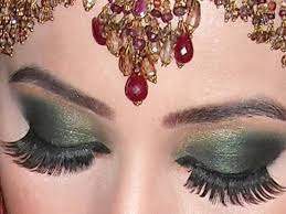now this one is another perfect eye makeup style for green and golden colour bination shades covered by a sparkly texture