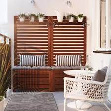 ikea uk garden furniture. A Balcony With Brown Wooden Storage Benches Seat Cushions, Wall Panels And Shelves Filled Ikea Uk Garden Furniture