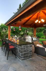 Entertaining Space Complete With An Outdoor Kitchen Structures