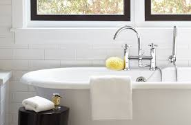elegant freestanding tubs in bathroom transitional with freestanding tub with wall mount filler next to bathtub