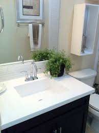 white marble top integrated with fancy white trough sink on floating vanity