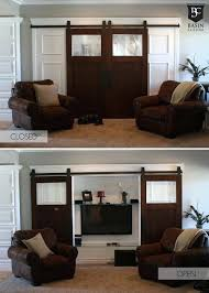 barn door tv cover cabinet over fireplace the perfect solution for husband and wife