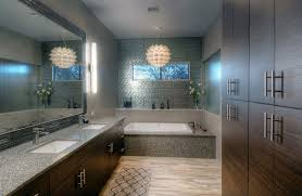 latest modern bathroom with brown vanities and pendant chandelier over bathtub with chandelier over bathtub