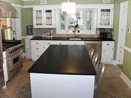 marble countertops white kitchen black countertops lighting flooring cabinet table island backsplash cut tile stone