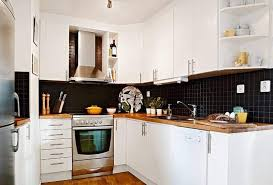 black and white kitchens black backsplash and white cabinets and butcherblock countertop awesome black and