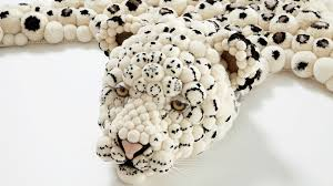 animal rugs by myk animal skin rugs a black and white spotted cat