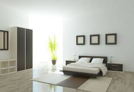 bedroom minimalist. Minimalist Bedroom Design With White Painted Wall And Decorative Frames Also Sheet Bedding On Wood