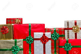 A group of gift wrapped Christmas presents with bows and ribbons, isolated  on a white