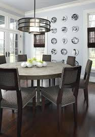 light wood round dining table round dining table room contemporary with dark wood flooring white shade