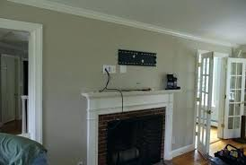 mount above fireplace hide wires on wall mounted beautiful over hiding pull down tv installation fir