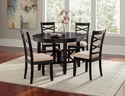 gothic round black dining table set on neutral