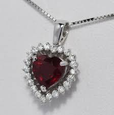 18 ct white gold ruby and diamonds pendant including chain with length 45 cm