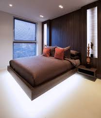 Brown modern bedroom with floating bed