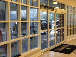 removed swing doors and installed sliding glass doors