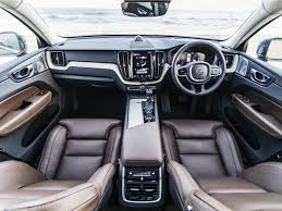 the new volvo xc60 is available in four exterior colour options black white brown and grey and three interior colour options amber maroon brown