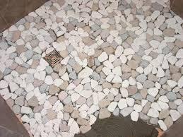 pebble tile shower floor lines between sheets are visible at the left pebble tile shower floor