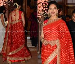 red saree style and makeup tips how to style red saree makeup looks for red saree madhuri dixit red saree makeup and hairstyle ideas