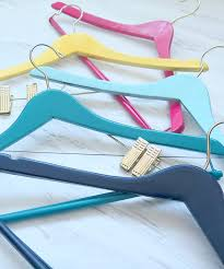diy painted wooden hangers make a fun and decorative splash of color