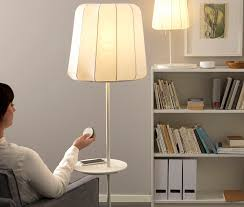 ikea is ing smart light bulbs that can be controlled wirelessly using a remote to turn